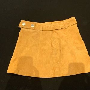 Yellow suede mini skirt with matching belt
